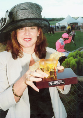 Debbie Gilbert holding the Breeders' Trophy after Porto Roca's Group 1 Coolmore Classic victory